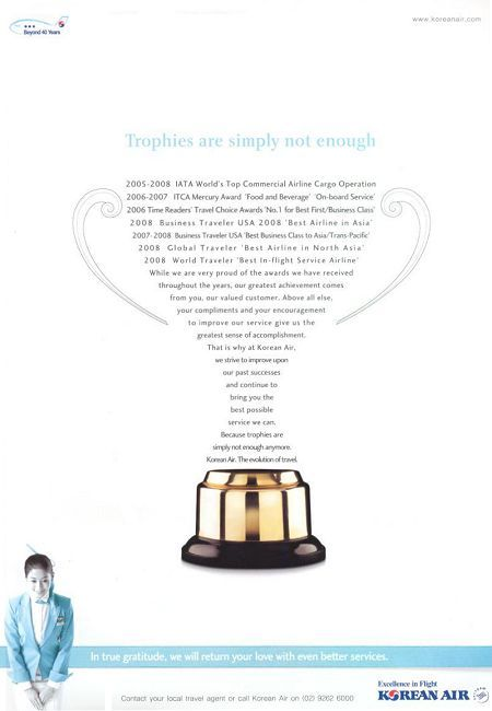 Korean Air advertisement titled: 'Trophies are simply not enough.', from the year 2010, shaped like a trophy.