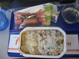 Chicken in creamy sauce, rice with vegetables